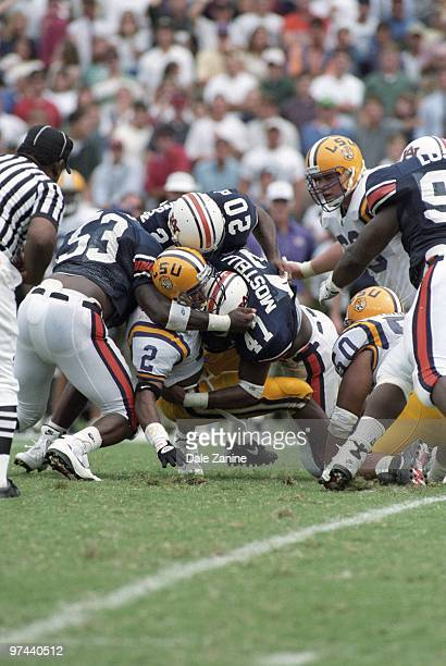 LSU Eddie Kennison in action during pileup tackle by Auburn defense Auburn AL 9/17/1994 CREDIT Dale Zanine