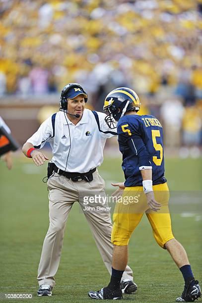 Michigan coach Rich Rodriguez and QB Tate Forcier victorious during game vs Notre Dame. Ann Arbor, MI 9/12/2009 CREDIT: John Biever