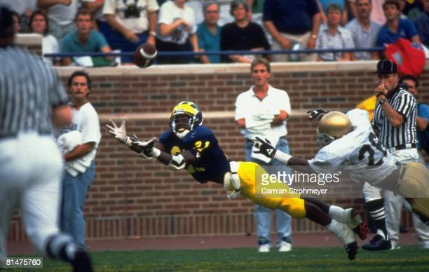 College Football Michigan Desmond Howard in action diving and making catch before scoring touchdown during 4th down play vs Notre Dame Ann Arbor MI...