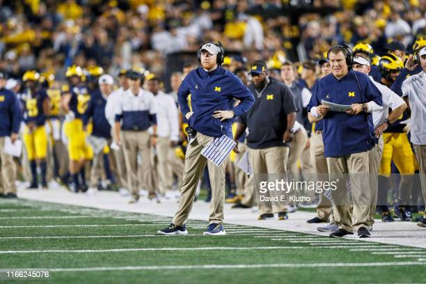 Michigan running backs/cospecial teams coordinator Jay Harbaugh on field during game vs Middle Tennessee State at Michigan Stadium Ann Arbor MI...