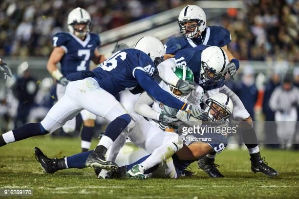 Michigan State Javon Ringer in action rushing vs Penn State Jared Odrick at Michigan State at Beaver Stadium State College PA CREDIT Al Tielemans