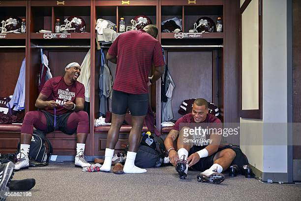 Mississippi State QB Dak Prescott with backup quarterbacks Elijah Staley and Damian Williams getting dressed in locker room before game vs Texas AM...