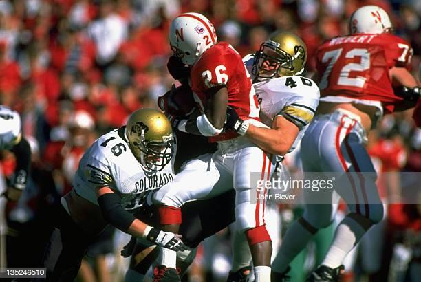 Nebraska Clinton Childs in action vs Colorado Matt Russell and Ted Johnson at Memorial Stadium. Lincoln, NE CREDIT: John Biever