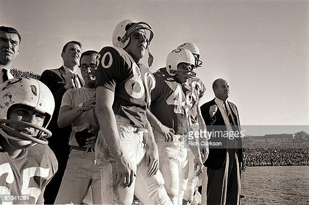 College Football Nebraska coach Bob Devaney with assistant coach Tom Osborne on sidelines during game vs Kansas Lincoln NE 11/9/1963