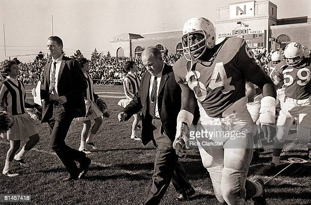 College Football Nebraska coach Bob Devaney with asstistant coach Tom Osborne walking on field before game vs Kansas Lincoln NE 11/9/1963