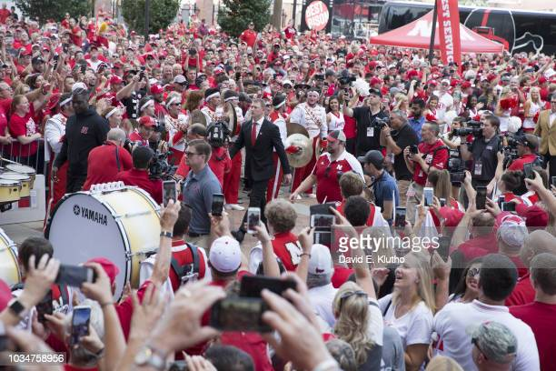 Nebraska coach Scott Frost and players walking through fans outside Memorial Stadium before game vs Akron Lincoln NE CREDIT David E Klutho