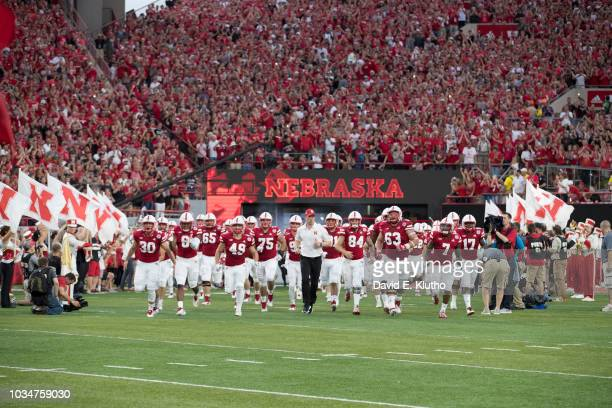Nebraska coach Scott Frost taking field with his players before game vs Akron at Memorial Stadium Lincoln NE CREDIT David E Klutho
