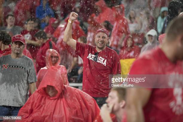 Nebraska fan in stands in the rain during game vs Akron at Memorial Stadium Weather Lincoln NE CREDIT David E Klutho