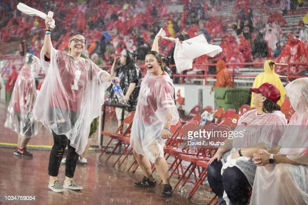 Nebraska fans in stands in the rain during game vs Akron at Memorial Stadium Weather Lincoln NE CREDIT David E Klutho