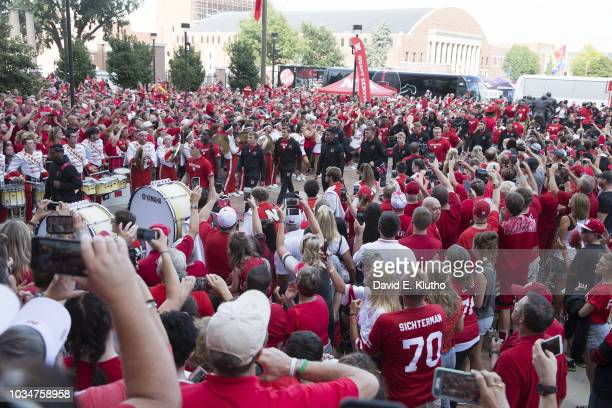 Nebraska players walking through fans outside Memorial Stadium before game vs Akron Lincoln NE CREDIT David E Klutho