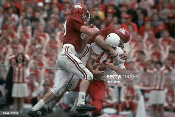 Nebraska QB Bob Churchich in action during sack by Arkansas defense at Cotton Bowl Stadium Dallas TX CREDIT Neil Leifer