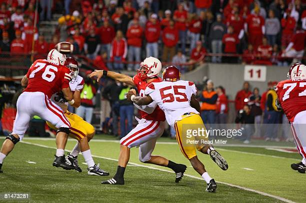 College Football Nebraska QB Sam Keller in action under pressure as USC Keith Rivers rushes passer Lincoln NE 9/15/2007