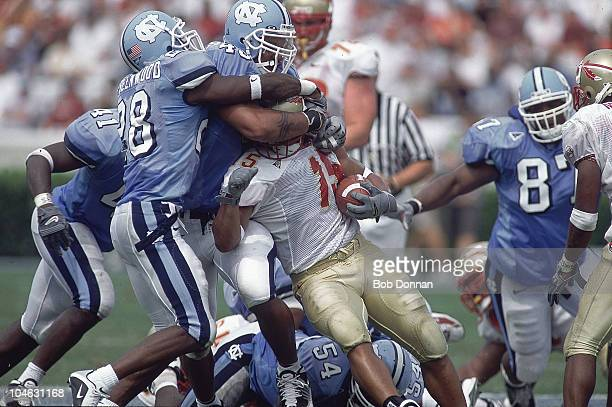 North Carolina Julius Peppers and BillyDee Greenwood in action making tackle vs Florida State William McCray Chapel Hill NC 9/22/2001 CREDIT Bob...