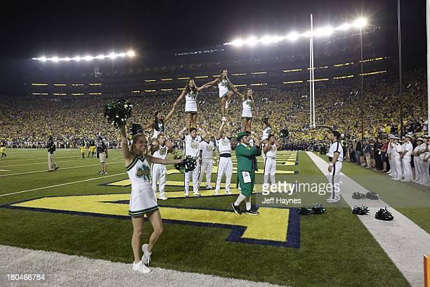 Notre Dame cheerleaders forming pyramid on field during game vs Michigan at Michigan Stadium Ann Arbor MI CREDIT Jeff Haynes