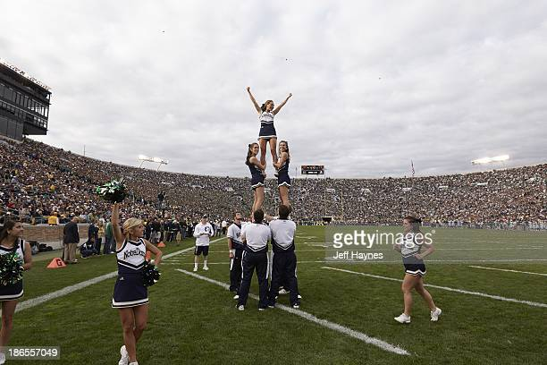 Notre Dame cheerleaders forming pyramid on field during game vs Michigan State at Notre Dame Stadium Closeup view of tuba South Bend IN CREDIT Jeff...