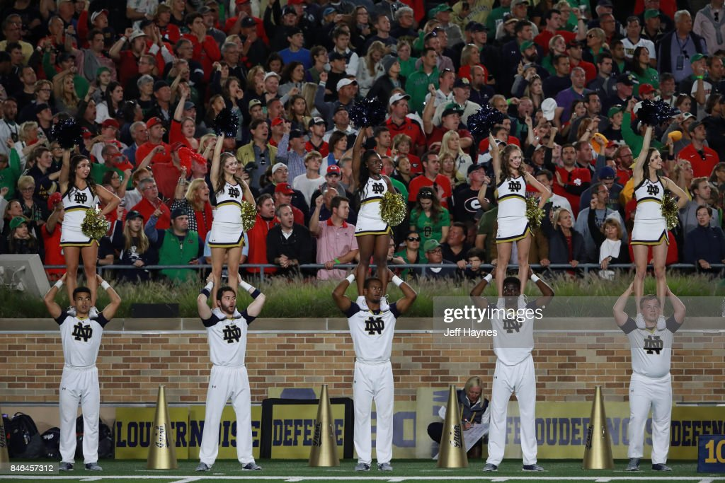 Notre Dame cheerleaders on field during game vs Georgia at ...