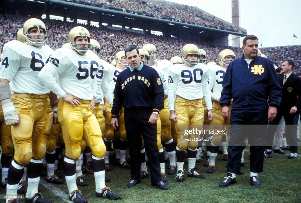604079984 Michigan State University vs University of Notre Dame. College Football  Notre  Dame coach Ara Parseghian with players on field before game ...