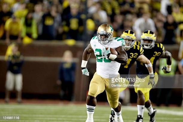 Notre Dame Jonas Gray in action rushing vs Michigan at Michigan Stadium First night game in history at The Big House Ann Arbor MI CREDIT Damian...