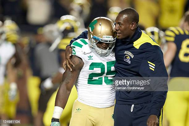 Notre Dame Jonas Gray with Michigan player after game at Michigan Stadium First night game in history at The Big House Ann Arbor MI CREDIT Damian...