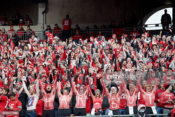 Ohio State fans in stands with body paint that reads JIM HARBUTT in reference to Michigan coach Jim Harbaugh during game at Ohio Stadium Columbus OH...