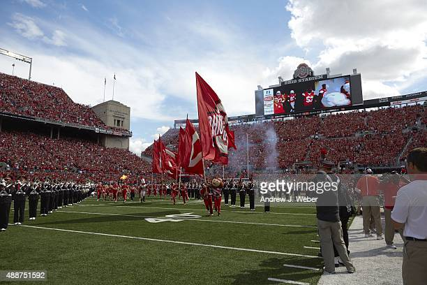 Ohio State mascot Brutus Buckeye taking field and carrying flag before game vs Hawaii at Ohio Stadium Columbus OH CREDIT Andrew J Weber