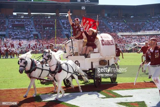 Oklahoma mascot Sooner Schooner on field with cheerleaders during game vs Iowa State at Gaylord Family Oklahoma Memorial Stadium Norman OK CREDIT...