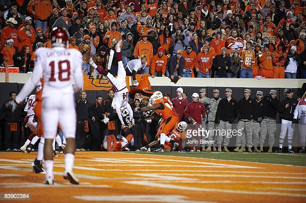 Oklahoma QB Sam Bradford in action getting upended and knocked out of bounds short of goal line vs Oklahoma State during 3rd quarter Stillwater OK...