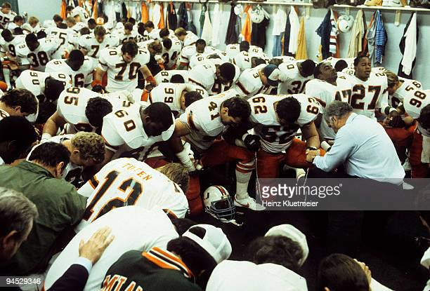 Orange Bowl Miami head coach Howard Schnellenberger leading prayer during halftime vs Nebraska Miami FL 1/2/1984 CREDIT Heinz Kluetmeier