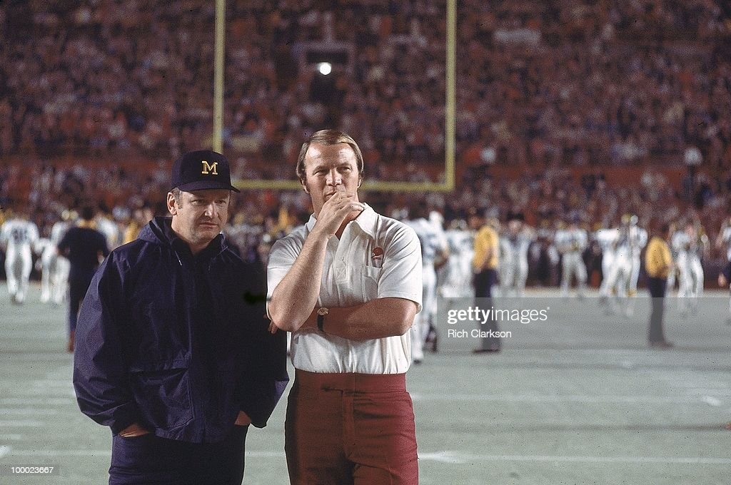 Michigan coach Bo Schembechler (L) and Oklahoma coach Barry Switzer (R) on field before game. Miami, FL 1/1/1976