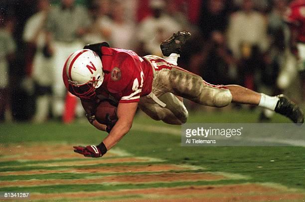 College Football: Orange Bowl, Nebraska Corey Schlesinger in action, diving into endzone and scoring TD vs Miami, Miami, FL 1/1/1995