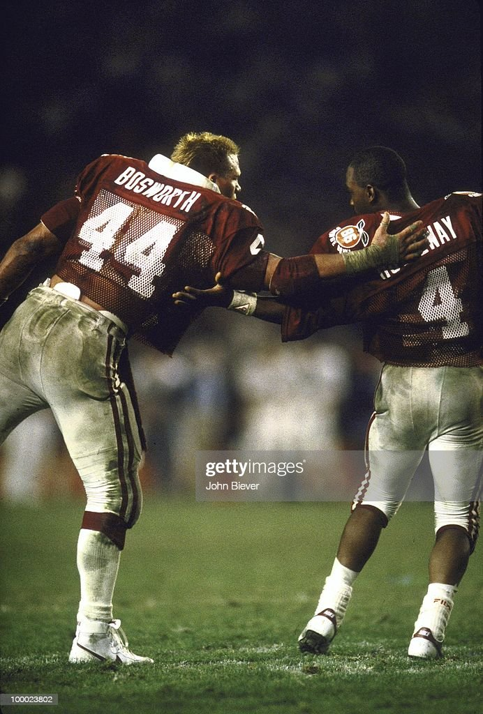 Oklahoma Brian Bosworth (44) and QB Jamelle Holieway (4) talking during game vs Penn State. Miami, FL 1/1/1986