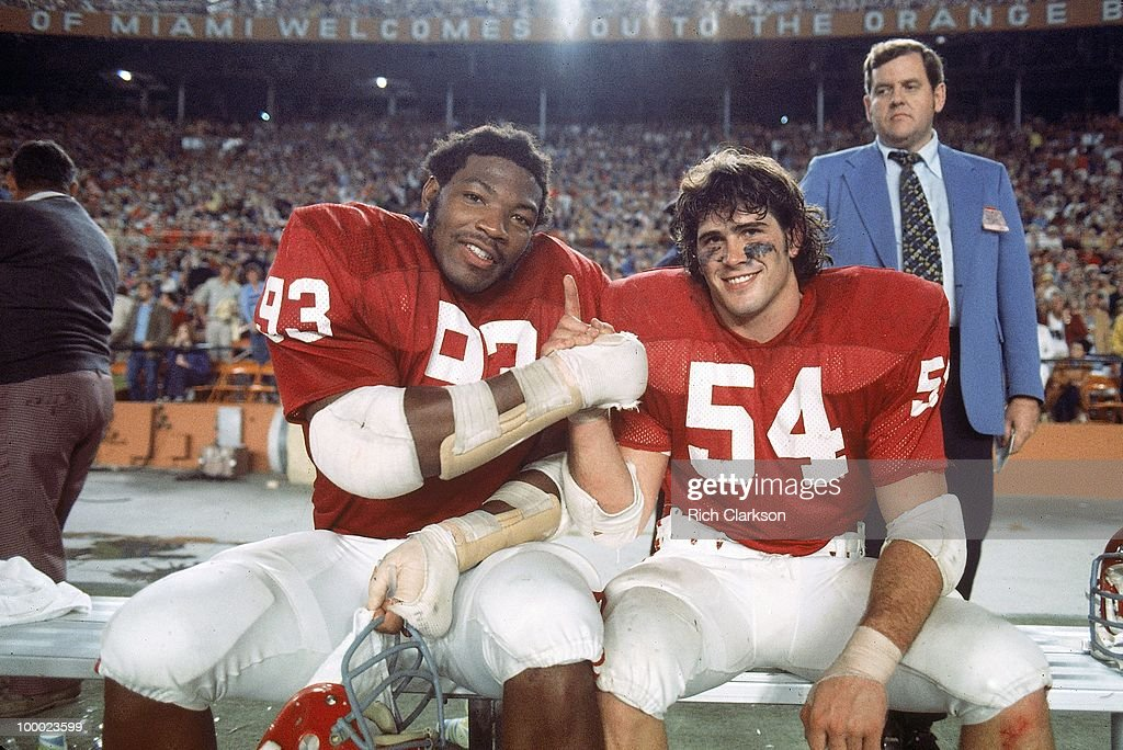 Oklahoma Lee Roy Selmon (93) and Jimbo Elrod (54) victorious on sidelines bench after winning National Championship game vs Michigan. Miami, FL 1/1/1976