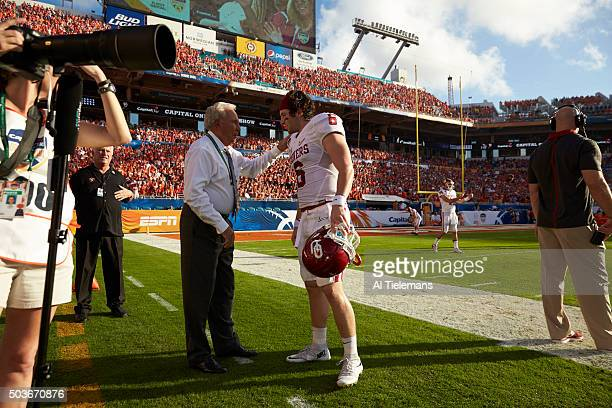 Orange Bowl: Oklahoma QB Baker Mayfield talking to ESPN analyst Lee Corso on field before game vs Clemson during College Football Playoff Semifinal...