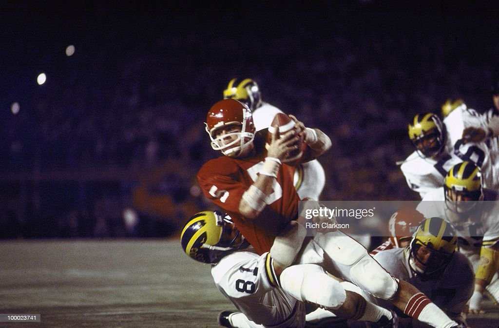Oklahoma QB Steve Davis (5) in action during tackle by Michigan. Miami, FL 1/1/1976