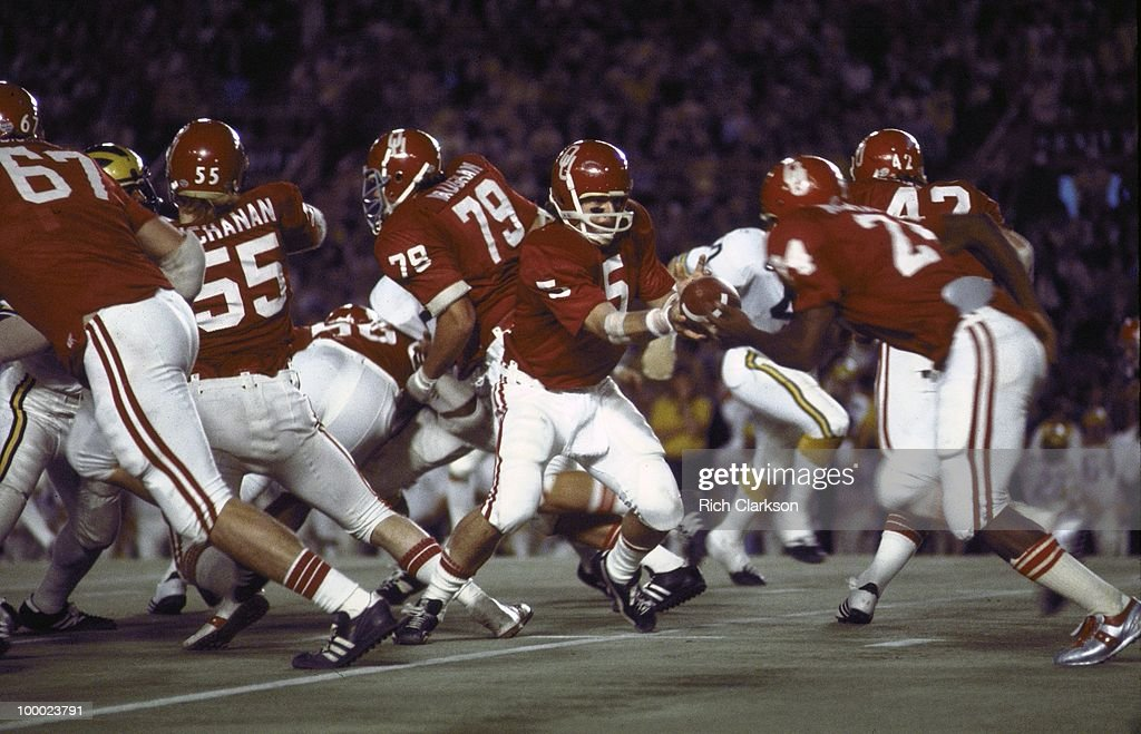 Oklahoma QB Steve Davis (5) in action, handoff to teammate Joe Washington (24) vs Michigan. Miami, FL 1/1/1976
