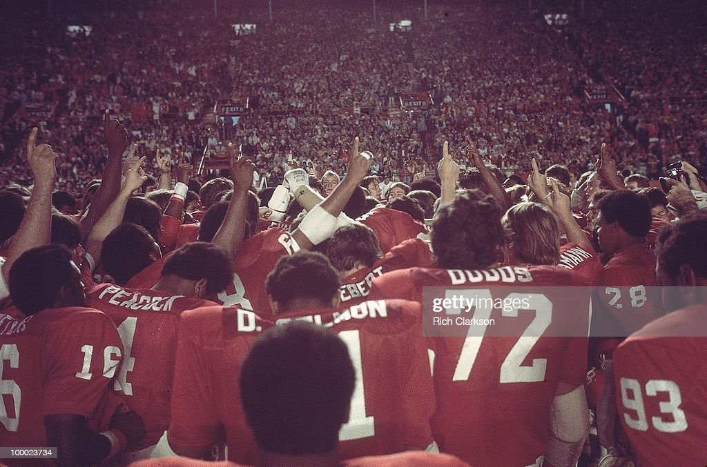 Oklahoma team and coaches victorious on field during celebration after winning National Championship game vs Michigan. Miami, FL 1/1/1976