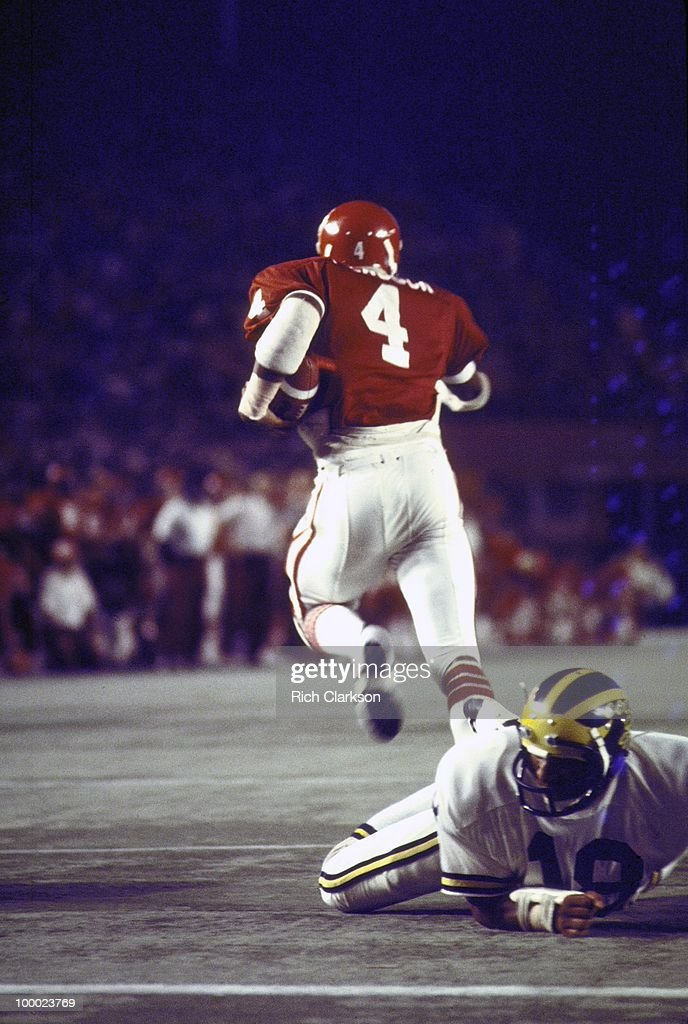 Rear view of Oklahoma Elvis Peacock (4) in action vs Michigan. Miami, FL 1/1/1976