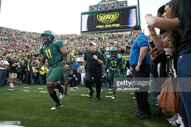 Oregon coach Chip Kelly taking field with players before game game vs Stanford. Eugene, OR 10/2/2010 CREDIT: Jed Jacobsohn