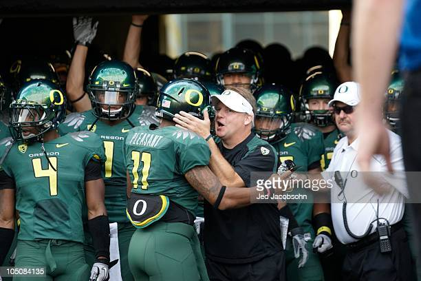 Oregon coach Chip Kelly with Eddie Pleasant before game vs Stanford. Eugene, OR 10/2/2010 CREDIT: Jed Jacobsohn