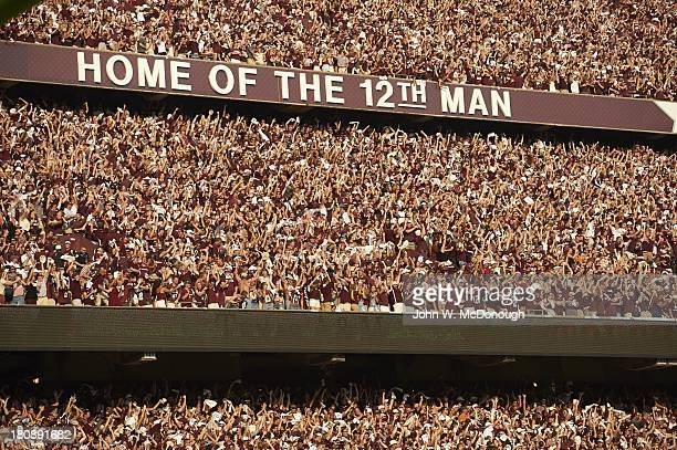 Overall view of fans in stands during Texas AM vs Alabama game at Kyle Field View of banner sign reading HOME OF THE 12TH MAN College Station TX...