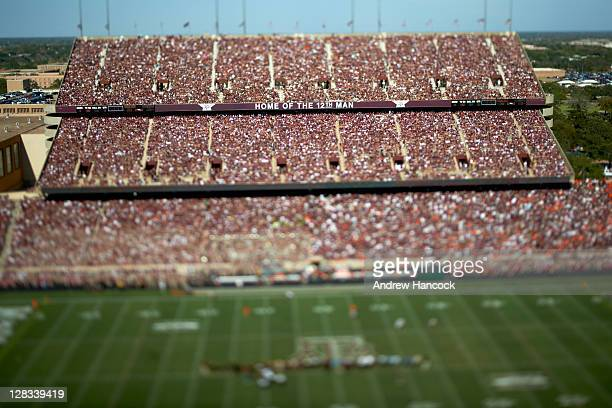 Overall view of Texas AM fans in stands with HOME OF THE 12TH MAN banner sign during game vs Oklahoma State at Kyle Field Image was taken with a...