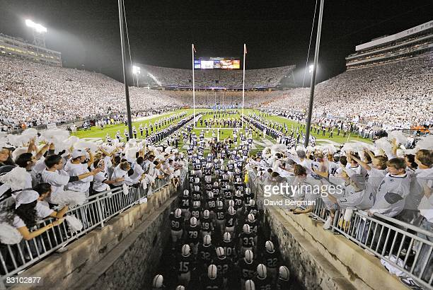 """Penn State fans dressed for """"White Out"""" game as team enters Beaver Stadium from tunnel before game vs Illinois. University Park, PA 9/27/2008 CREDIT:..."""