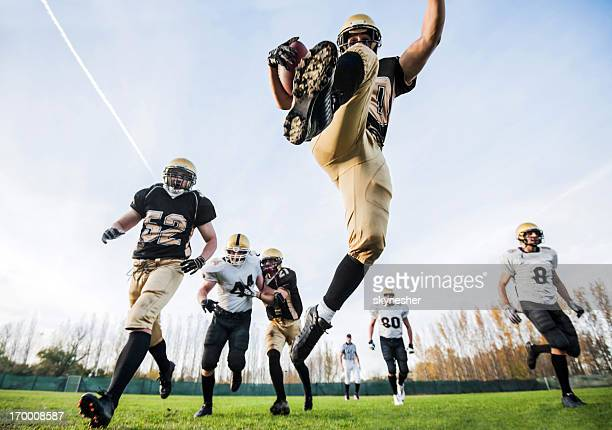 college football. - defender soccer player stock photos and pictures