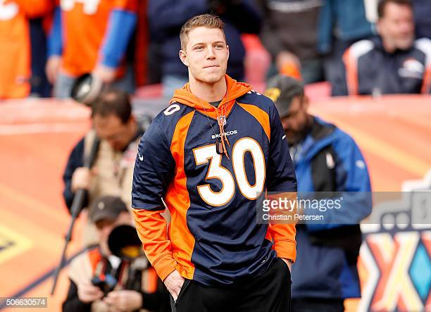 College football player Christian McCaffrey of the Stanford Cardinal looks on from the sideline in the AFC Championship game between the New England...