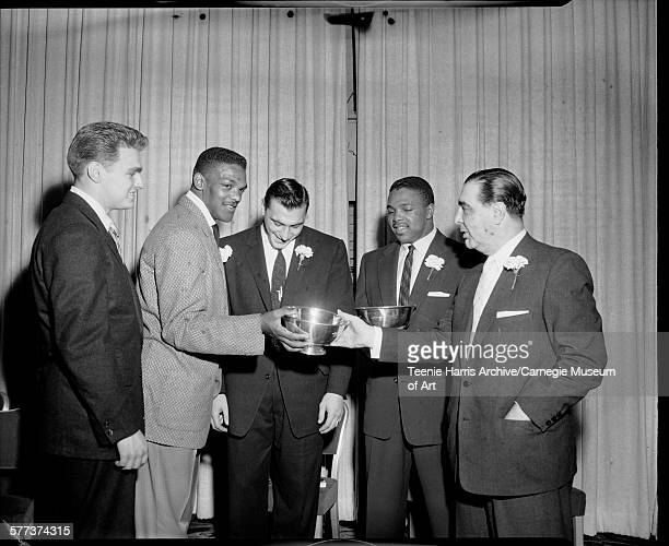 Penn State quarterback Don Bailey Penn State football player Lenny Moore receiving award Allen Ameche University of Pittsburgh player Henry Ford and...