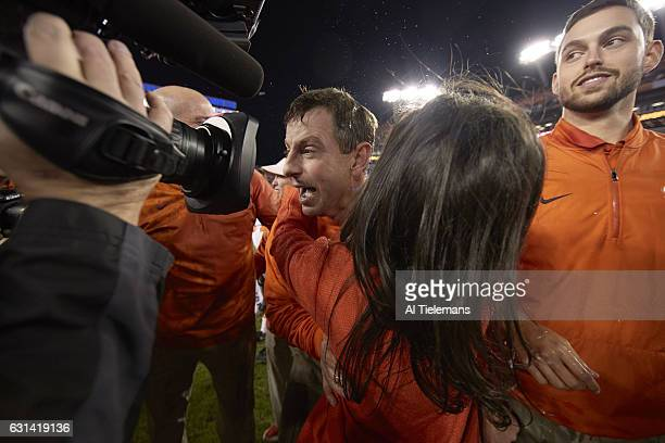 Playoff National Championship Clemson coach Dabo Swinney victorious hugging wife Kathleen after winning game vs Alabama at Raymond James Stadium...
