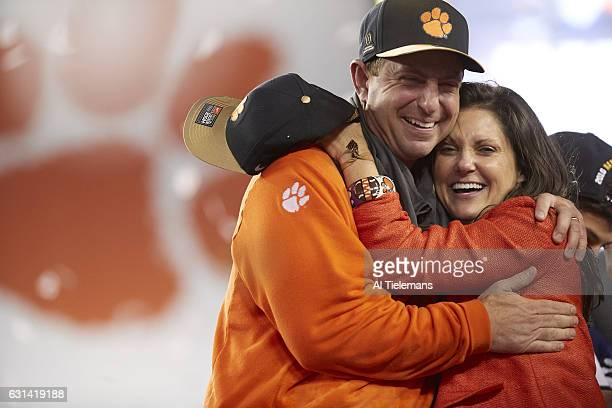 Playoff National Championship Clemson coach Dabo Swinney victorious with wife Kathleen after winning game vs Alabama at Raymond James Stadium Tampa...