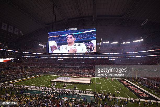 Playoff National Championship Overall view of Oregon QB Marcus Mariota on video screen during national anthem before game vs Ohio State at ATT...