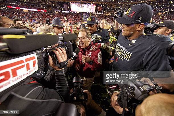 Playoff National Championship View of Alabama head coach Nick Saban victorious surrounded by media after winning game vs Clemson at University of...