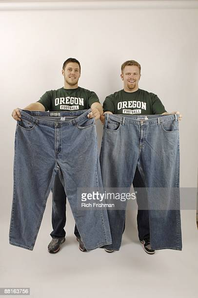 Portrait of former Oregon players Jeff Kendall and Cole Linehan holding up an old pair of jeans Both explayers lost at least 30 pounds since their...